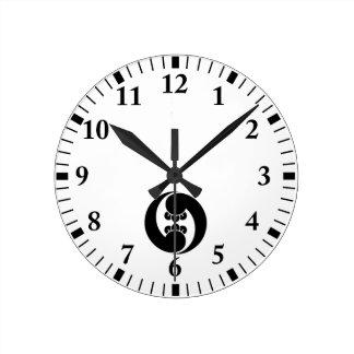 Two  counterclockwise clove swirls wall clocks
