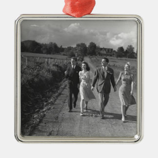 Two couples walking on country road B&W Silver-Colored Square Decoration