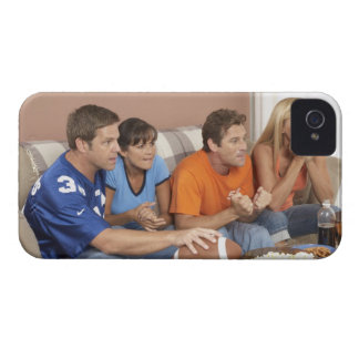 Two couples watching football in living room iPhone 4 case