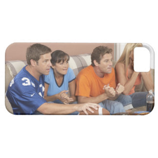 Two couples watching football in living room iPhone 5 cases