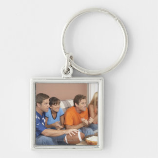 Two couples watching football in living room Silver-Colored square key ring