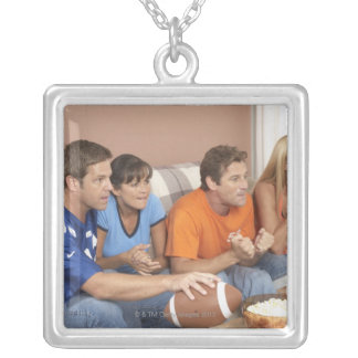 Two couples watching football in living room silver plated necklace