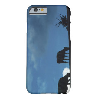 Two cows in silhouette grazing on hillside barely there iPhone 6 case