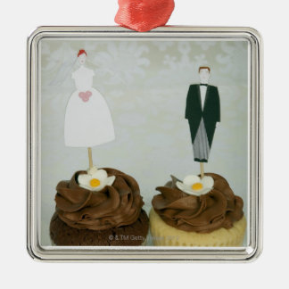 Two cupcakes with toy bride and groom on them Silver-Colored square decoration