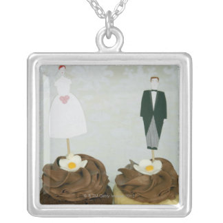 Two cupcakes with toy bride and groom on them silver plated necklace