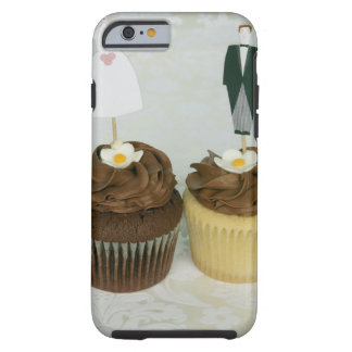 Two cupcakes with toy bride and groom on them tough iPhone 6 case
