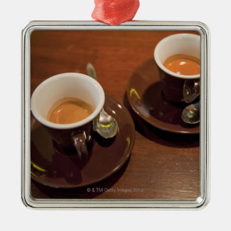 two cups of freshly brewed espresso coffee on a christmas ornament