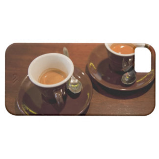 two cups of freshly brewed espresso coffee on a iPhone 5 cover