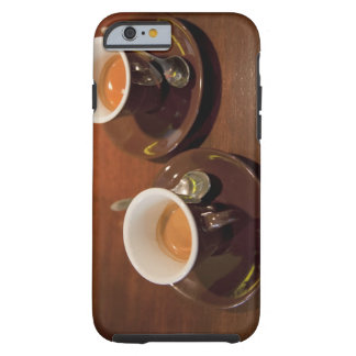 two cups of freshly brewed espresso coffee on a tough iPhone 6 case