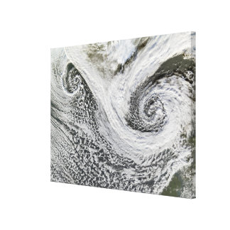 Two cyclones formed in tandem south of Iceland Canvas Print