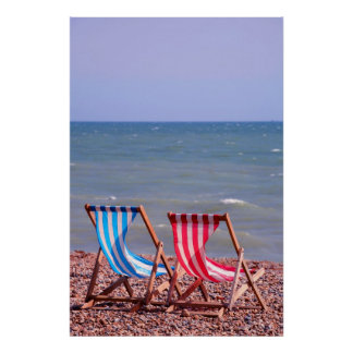 Two deckchairs on the beach poster
