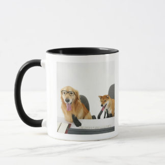 Two dogs wearing tie and glasses ,sitting on 2 mug