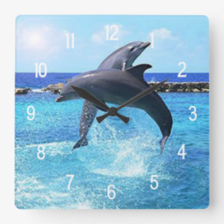 Two dolphins jumping doing tricks wallclock