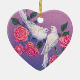 Two doves and flowers on a heart christmas ornament