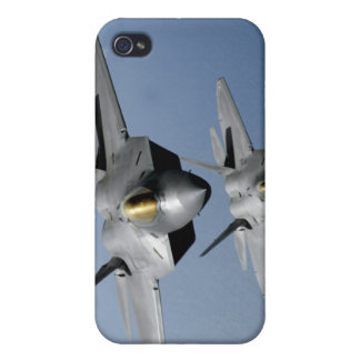 Two F-22 Raptors fly over the Pacific Ocean Covers For iPhone 4