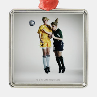 Two female soccer players in mid air heading christmas ornament