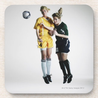 Two female soccer players in mid air heading coaster
