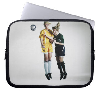 Two female soccer players in mid air heading laptop sleeve