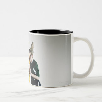 Two female soccer players in mid air heading coffee mugs