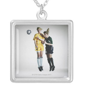 Two female soccer players in mid air heading silver plated necklace