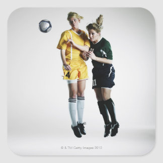 Two female soccer players in mid air heading square sticker