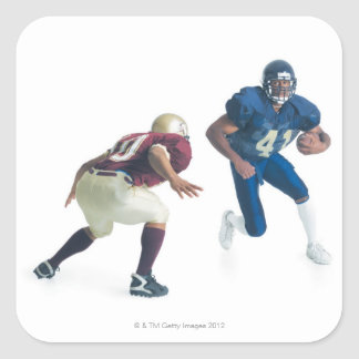 two football players from opposing teams are sticker