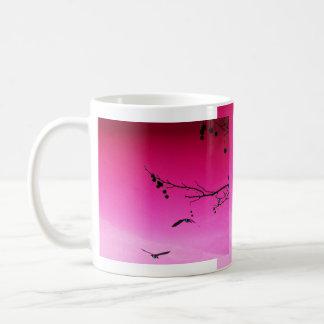 two geese flying in pink sky coffee mug