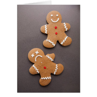Two gingerbread men on grey card
