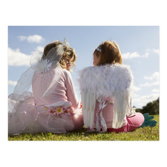 Two girls (7-9) dressed as angel and fairy postcard