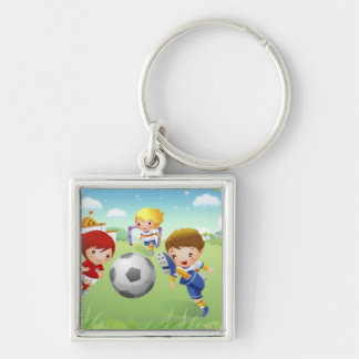 Two girls and a boy playing soccer key ring