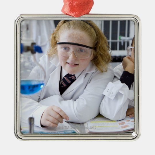 Two girls in school uniform wearing lab coats christmas ornament