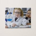 Two girls in school uniform wearing lab coats jigsaw puzzle