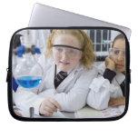 Two girls in school uniform wearing lab coats laptop computer sleeve