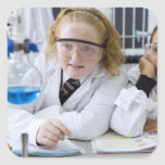 Two girls in school uniform wearing lab coats square sticker