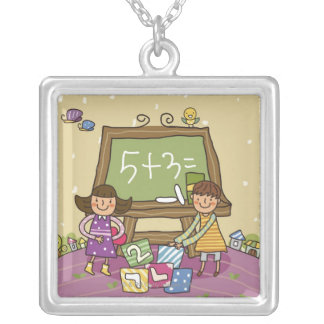 Two girls standing in front of a blackboard silver plated necklace