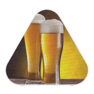 Two glasses of beers on a wooden table