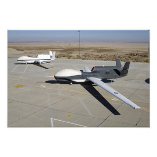 Two Global Hawks parked on a ramp Photo
