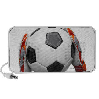 Two goal keepers gloves holding a football mini speaker