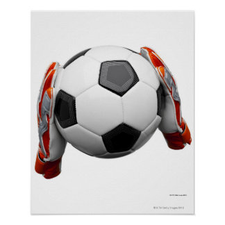 Two goal keepers gloves holding a football poster