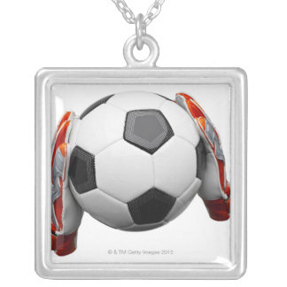 Two goal keepers gloves holding a football silver plated necklace