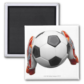 Two goal keepers gloves holding a football square magnet