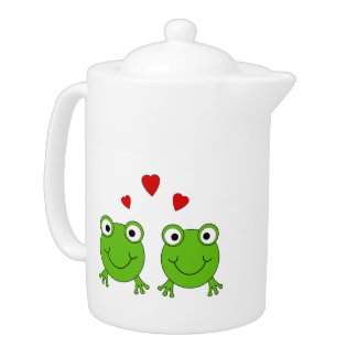 Two green frogs with red hearts.
