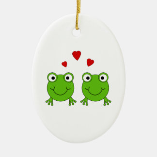 Two green frogs with red hearts. ceramic oval decoration