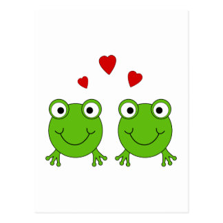 Two green frogs with red hearts. postcard