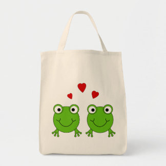 Two green frogs with red hearts. tote bag