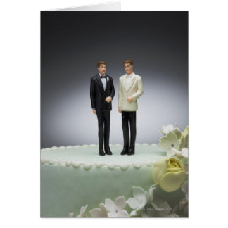 Two groom figurines on top of wedding cake greeting card