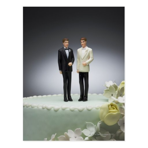 Two groom figurines on top of wedding cake post cards