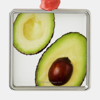 Two halves of an an avocado, on white christmas ornament
