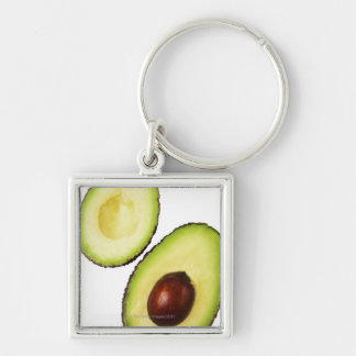 Two halves of an an avocado, on white key ring