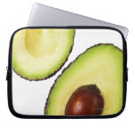 Two halves of an an avocado, on white laptop computer sleeve